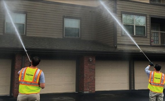Townhome being pressure washed