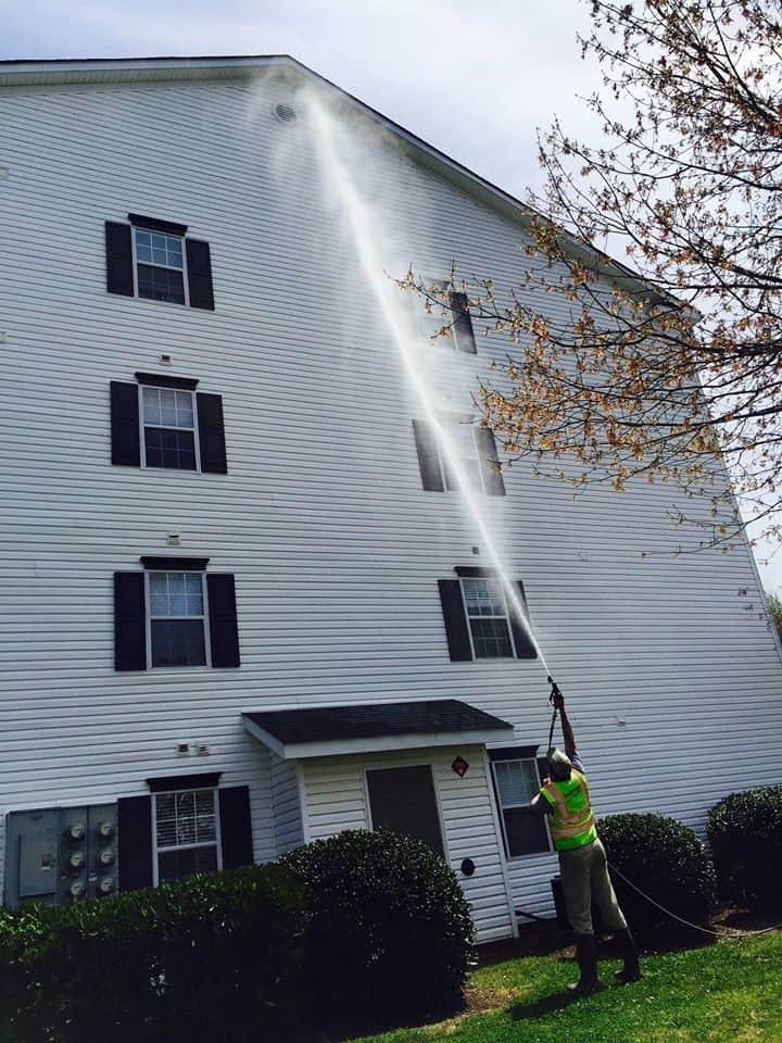 Pressure washing an apartment building in Clemson SC
